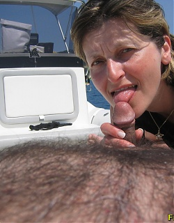 Skinny blonde mature is sucking small dick on a yacht until man cum