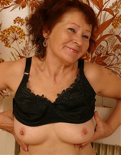 Hot brunette grandmom is undressing and showing shaved pussy and ass